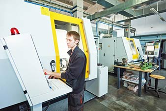 CNC Machine operated by human and monitored by M-Box System
